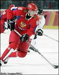 Malkin controlling the puck for Russia